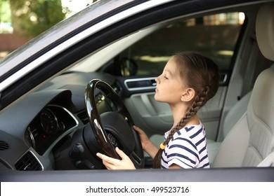 Girl driving parent car