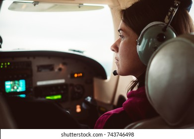Girl driving a small plane