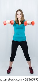 girl with dumpbells on white background sport concept gym