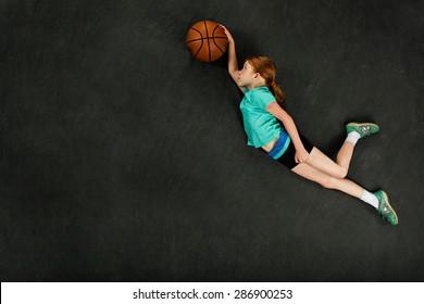 Girl dunking basketball