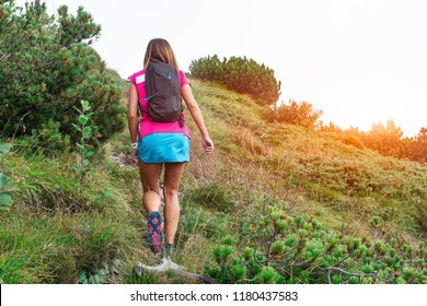 Girl during a trekking alone in the mountains.