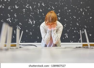 Girl with dyslexia or dyslexia in school