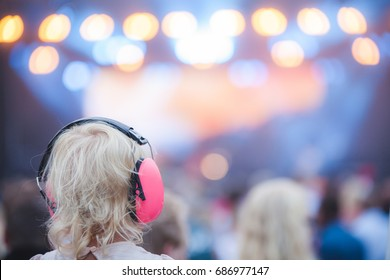 Girl with ear protectors on concert