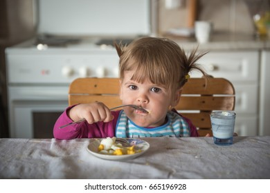 The girl is eating alone