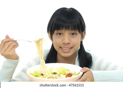 Girl eating asian noodle soup