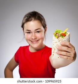 Girl eating big sandwich