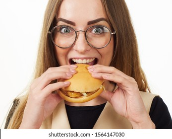 girl eating a burger on a white background