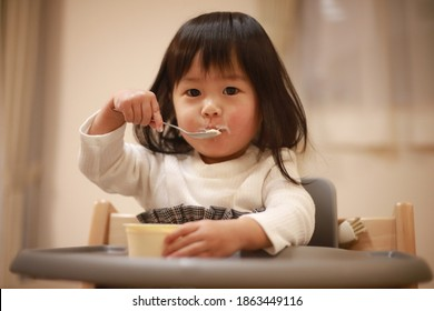 Girl eating cup ice cream