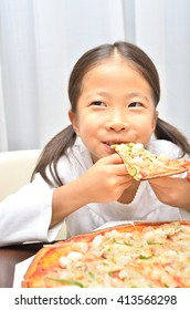 Girl eating delicious pizza