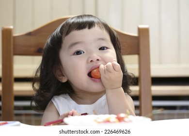 Girl eating a favorite cherry