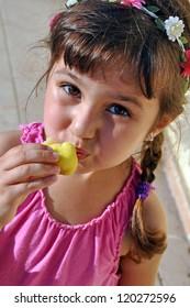 Girl eating figs