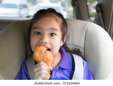 Girl Eating Fried Chicken on car