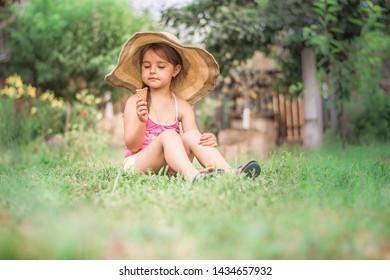 girl eating ice cream in the garden