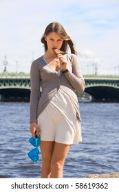 girl eating ice cream on the waterfront