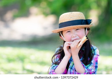 Girl eating sandwich at lunchtime