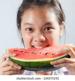 Girl eating water melon
