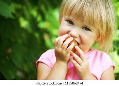 a girl eats an apple