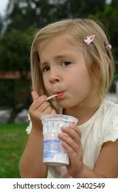 the girl eats ice-cream