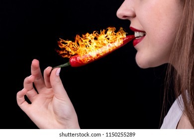 Girl eats red chilli pepper with fire