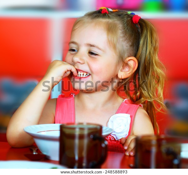Girl eats soup plates