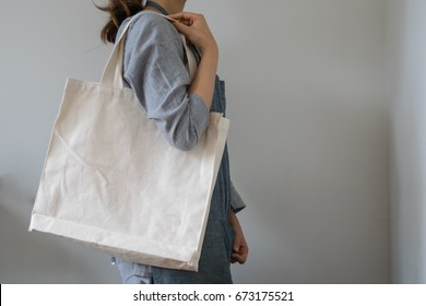 a girl with eco natural white canvas totebag