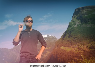 girl with the electronic cigarette in the mountains near the lake. instagram photo  e-cigarette. Photo instagram style. vintage retro.