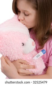 The girl embraces and kisses a toy-bear