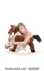 The girl embraces the toy horse