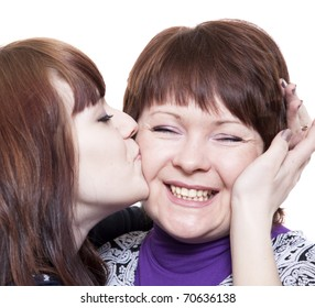 The girl emotionally embraces the woman
