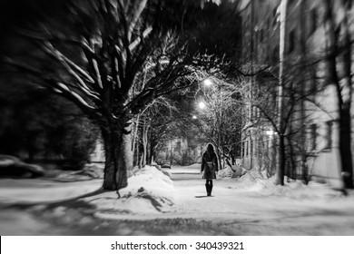 Girl in empry street at the dark night blur