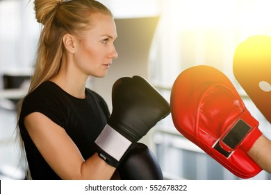 Girl engaged boxing with coach
