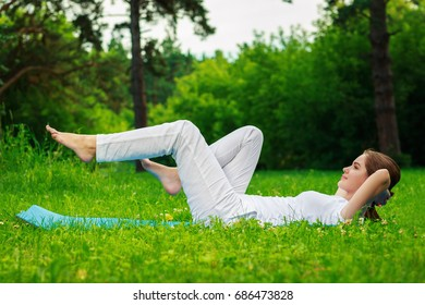 The girl is engaged in fitness, outdoor, summer