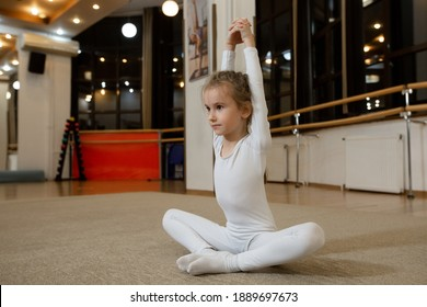 the girl is engaged in gymnastics in the gym