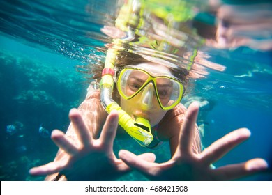 girl engaged in snorkeling in the Red Sea in Egypt
