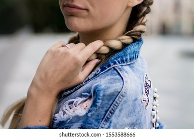 Girl with engagement ring and denim jacket
