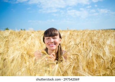 girl enjoy nature in the wheat field