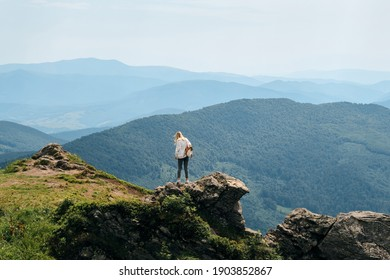 Girl enjoy scenics view on valley. Beautiful nature landscape in mountains. Hiking journey on tourist trail. Outdoor adventure. Travel and exploration. Healthy lifestyle, leisure activities