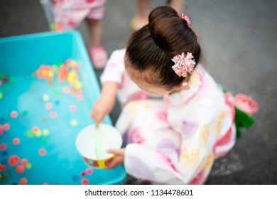 Girl to enjoy the summer festival of Japan