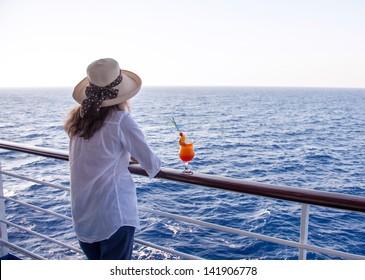 girl enjoying a cocktail while cruising