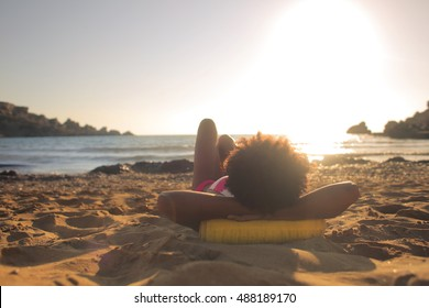 Girl enjoying the end of the day at the beach
