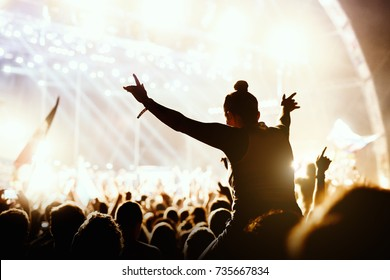 Girl enjoying the outdoor music festival concert. - Shutterstock ID 735667834
