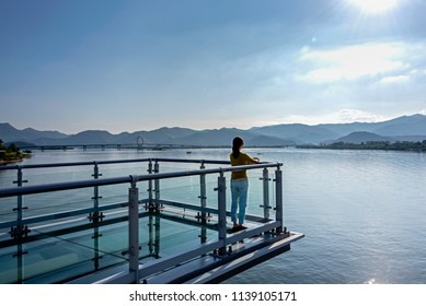 A girl enjoying the scenery at the Soyang River Skywalk. Chuncheon, South Korea