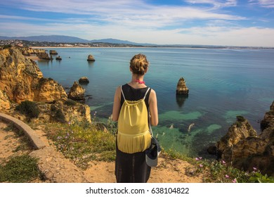 Girl enjoying the view from a cliff in Lagos, Algarve
