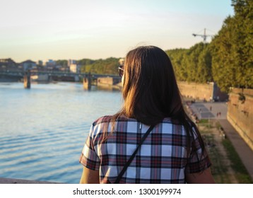 Girl is enjoying the view on a beautiful fiver prior the sunset.