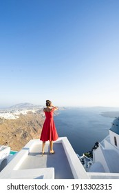 Girl enjoying the views of Santorini