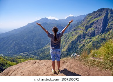 girl enjoys life at the top of the mountain in Ella, Sri Lanka