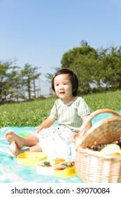 Girl enjoys picnic