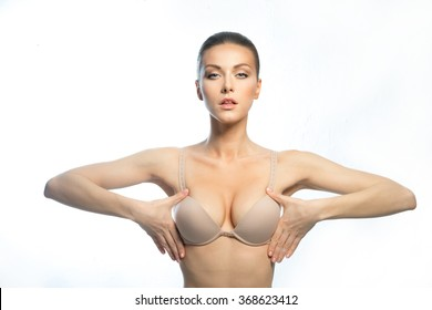 The girl of the European appearance, with a beautiful, large breasts, happy after plastic surgery.