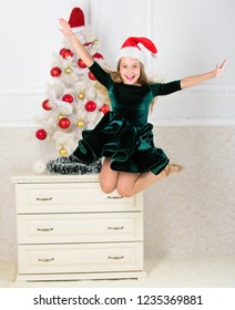 Girl excited about christmas jump mid air. Child emotional cant stop her feelings. Celebrate christmas concept. Girl in dress jumping. It is christmas. Day we have waited for all year finally here.