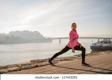 girl  exercise on coasts river